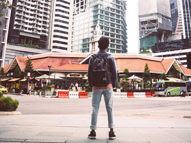 boy standing on the streets of a big city